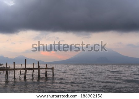 Pier on the Atitlan Lake in Guatemala at Sunrise - stock photo