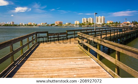 Pier on the Halifax River and view of Daytona Beach, Port Orange, Florida.