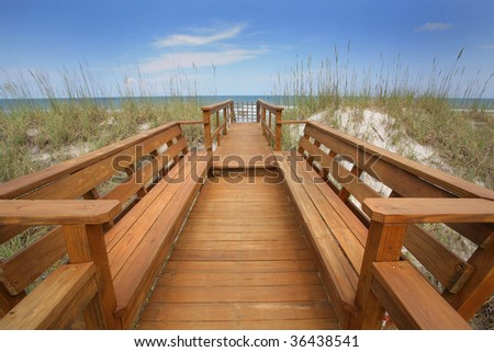 Pier Overlooking Gorgeous Blue Water - stock photo