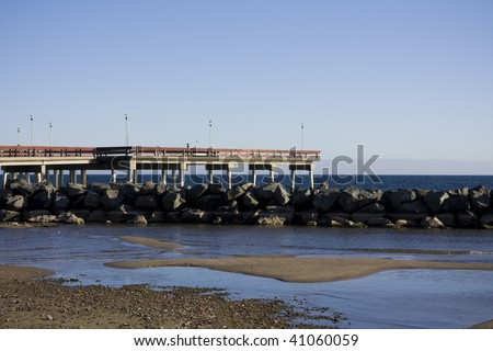 Pier overlooking lake ontario shot from toronto island - stock photo