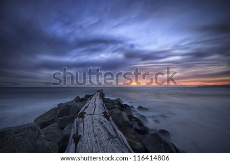 Pier to blue sunset - stock photo
