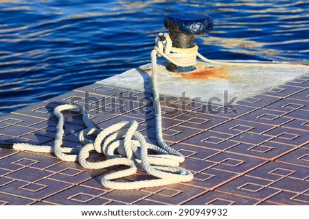 pier with a rope to tie ships to port - stock photo
