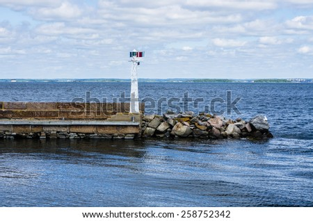 Pier with lighthouse in Karlskrona in Sweden.