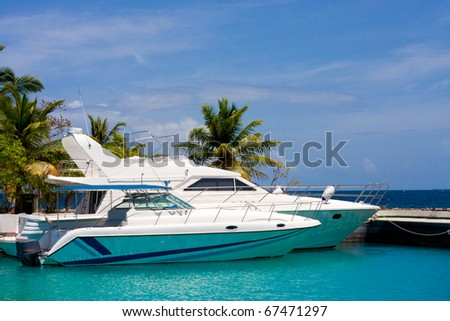 Pier with yachts - stock photo