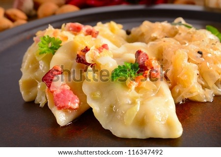 Pierogi.Polish  dish pierogi with sauerkraut and mushrooms - stock photo