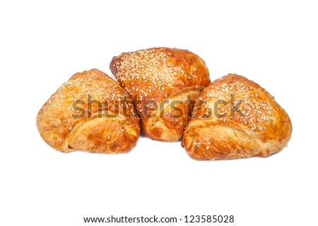 pies from flaky pastry strewed with sesame seeds