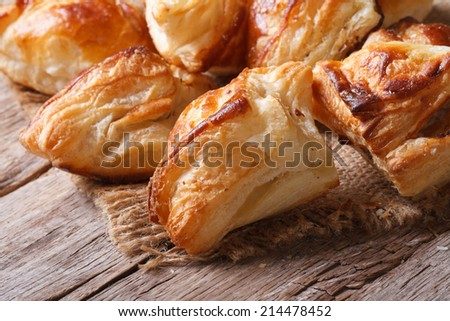 Pies of puff pastry close up on an old table. horizontal  - stock photo