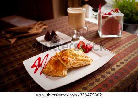 Pies of puff pastry close up on an sack background - stock photo