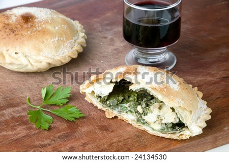 Pies served with red wine - stock photo