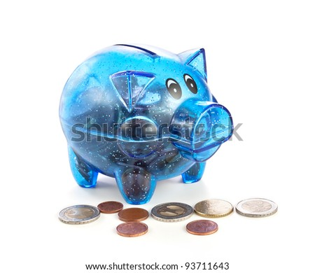 Pig a coin box with coins on a white background - stock photo