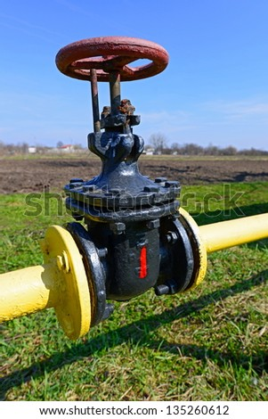 Pig-iron latch on the gas pipeline of low pressure - stock photo