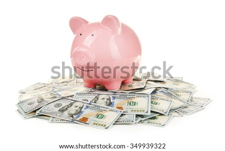 Pig moneybox and dollar banknotes isolated on white