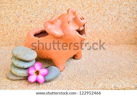 Pig statues laugh. - stock photo
