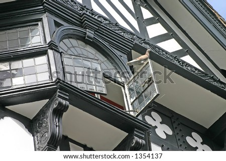 Pigeon on Open Window in Old Building in Chester UK - stock photo
