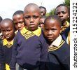 PIGGS PEAK, SWAZILAND-JULY 29: Unidentified orphan schoolboys on July 29, 2008 in Nazarene Mission School, Piggs Peak, Swaziland. Close to 10% of Swaziland's population are orphans, due to HIV/AIDS. - stock photo