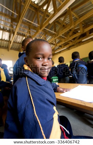 PIGGS PEAK, SWAZILAND-JULY 29: Unidentified schoolboy on July 29, 2008 in Nazarene Mission School, Piggs Peak, Swaziland. Close to 10% of Swazilands population are orphans, due to HIV/AIDS.