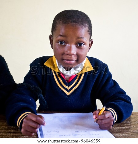 PIGGS PEAK, SWAZILAND-JULY 29: Unidentified Swazi schoolboy on July 29, 2008 in Nazarene Mission School, Piggs Peak, Swaziland. Close to 10% of Swaziland's population are orphans, due to HIV/AIDS. - stock photo