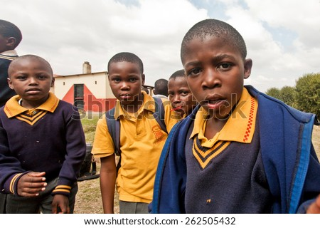 PIGGS PEAK, SWAZILAND-JULY 29: Unidentified Swazi schoolboys on July 29, 2008 in Nazarene Mission School, Piggs Peak, Swaziland. Close to 10% of the Swazi population are orphans, due to HIV/AIDS.