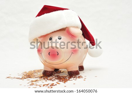 Piggy bank against white background. - stock photo