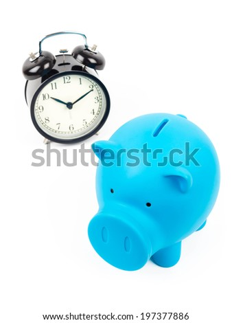 Piggy bank and alarm clock concept for saving time