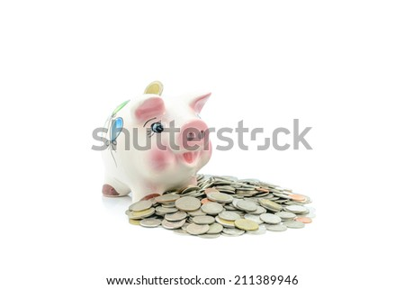 Piggy bank and baht - stock photo