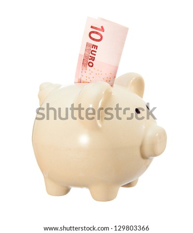 piggy bank and banknote ten euros..Isolated on white background