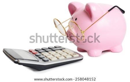 Piggy bank and calculator. Isolated on white background - stock photo