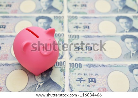 piggy bank and japanese money