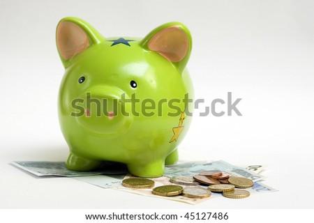 piggy bank and money - stock photo