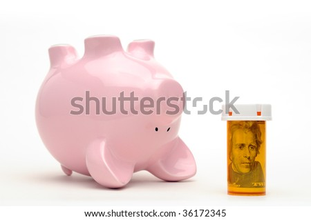 Piggy bank and pill bottle isolated on white background. Conceptual image about the financial challange of healthcare reform in the USA - stock photo