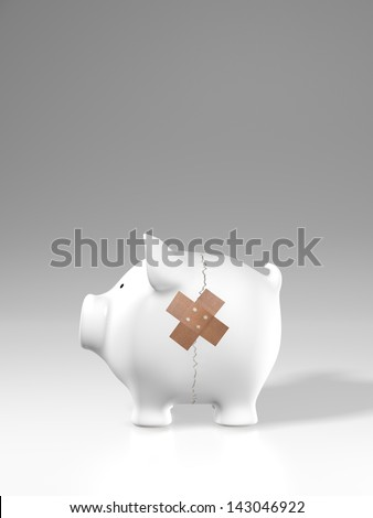 Piggy bank - crack and plaster - stock photo