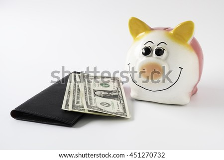 Piggy bank, dollars bill and wallet on white background.