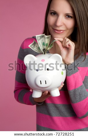 Piggy bank girl taking money - stock photo