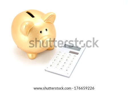 Piggy bank (Gold) and calculator isolated on white background.