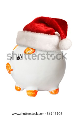 Piggy bank in Santa hat - stock photo