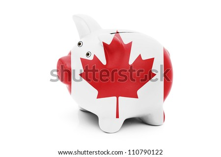 Piggy bank in the Canadian flag colors isolated on white, Money management for Canadians - stock photo