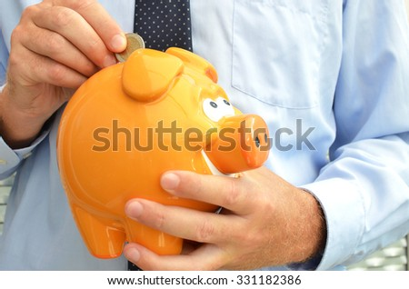 Piggy bank in the hands - stock photo