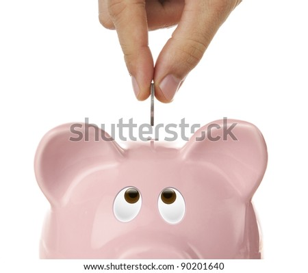 Piggy bank looking up for the coin isolated on white - stock photo