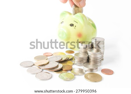 Piggy bank on a pile of coins
