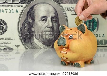 Piggy bank on big dollar background - stock photo