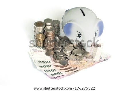 Piggy bank on coin and cash , Thai currency  - stock photo