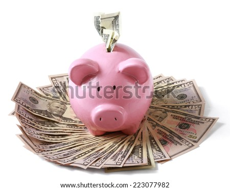 piggy bank on dollars, isolated on white background. - stock photo
