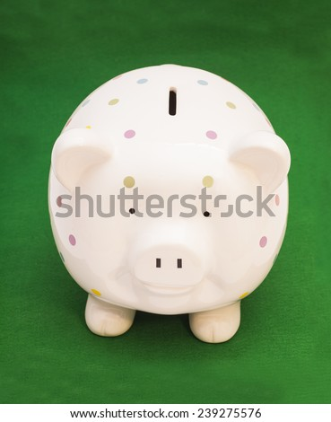 Piggy bank on green background