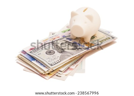 piggy bank on international banknote  - stock photo