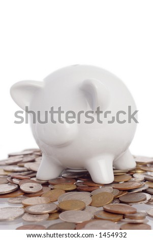 piggy bank on top of a pile of coins - stock photo