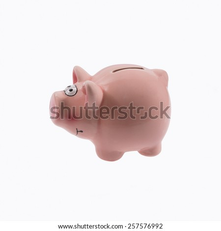 Piggy bank on white background . - stock photo