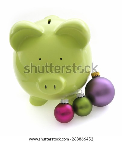 Piggy Bank on White Background with Christmas Ornaments - stock photo