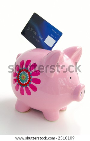 Piggy bank on white with a credit / debit card - stock photo