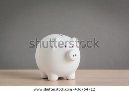 Piggy bank on wooden table - stock photo