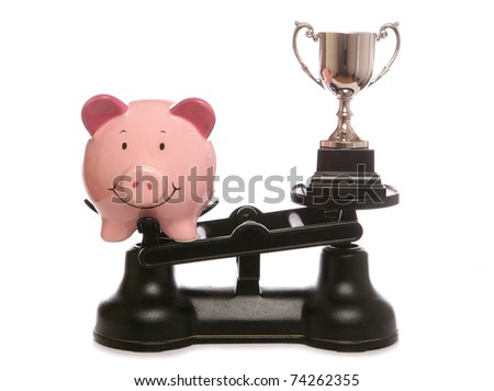piggy bank out weighing trophy studio cutout - stock photo